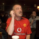 cheering man in red shirt