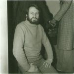 Man in polo neck with beard